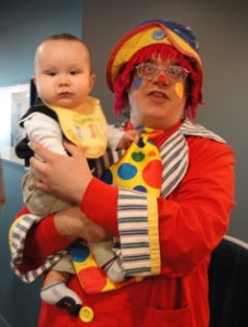 Picture of New York clown Amazing Danny with a baby